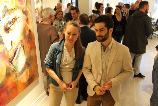 Galerie d'art Blanche : 2 clients talking about their new acquisition on Sheffer's exhibiition opening. April 2017
