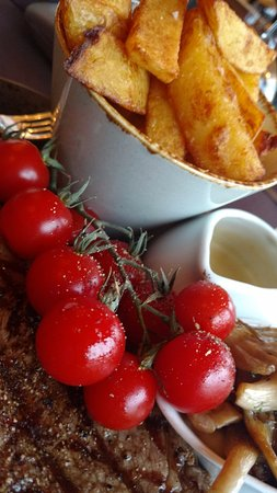Whaley Bridge, UK: Rib eye steak medium rare shitake mushrooms vine tomatoes choice of sauce