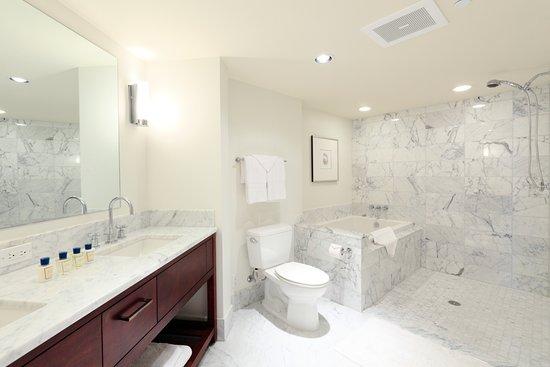 Trump International Hotel Waikiki: Spacious marble bathrooms feature Toto washlets, deep soaking tubs &