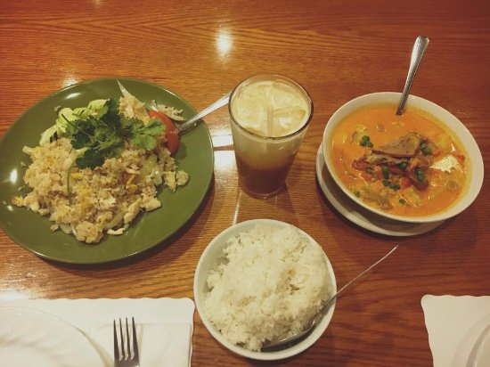 Sun City, AZ: Duck curry on the right, sticky rice on the bottom, That tea on top and basil chicken on the lef