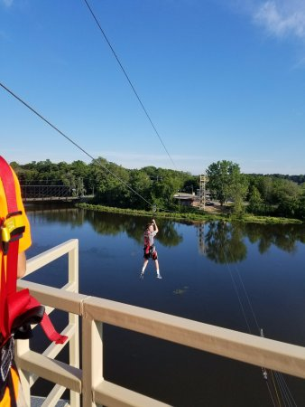 Allegan, MI: My little brother going across the zip line!