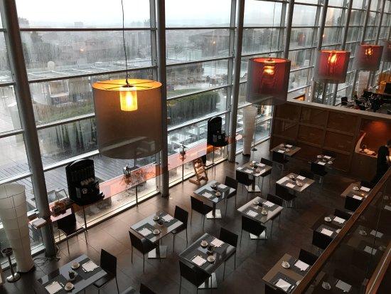AC Hotel Palau de Bellavista: Breakfast/dining area below, with deck outside.