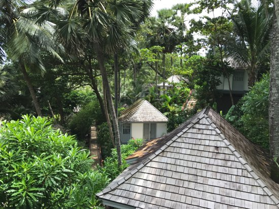 The Surin Phuket: Deluxe cottages on hillside above beach