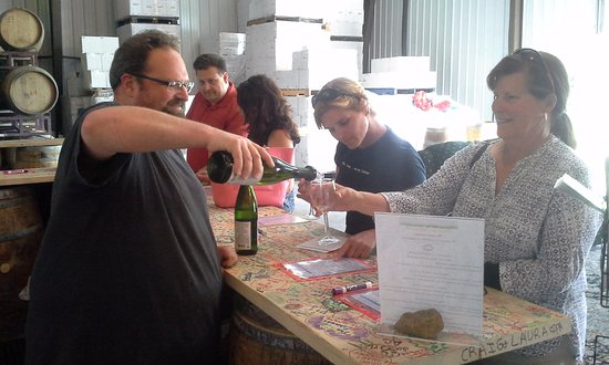 Penn Yan, NY: Our Tasting Room bar with our Winemaker, Bernard, pouring for some happy customers!