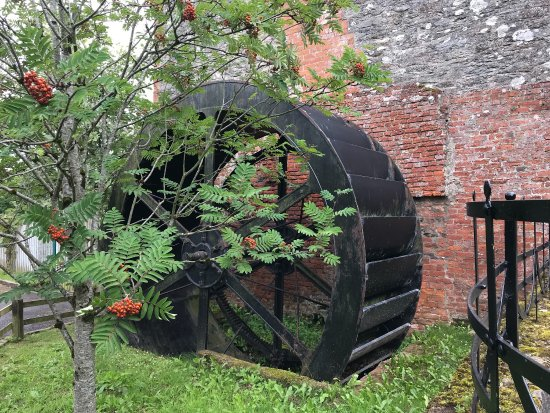 Limavady, UK: External exhibits of agricultural implements and a water wheel at the Green Lane Museum.  The wa