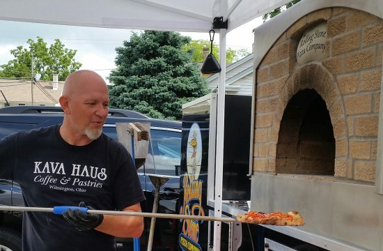 Wilmington, OH: Brad Heyes and daughter Emma prepare the Kava Haus Rolling Stone baked pizza at the Kava Haus, W