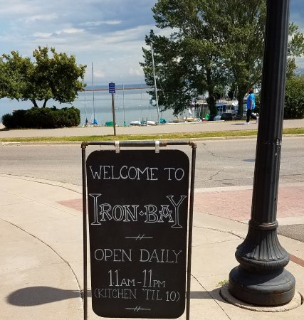 Iron Bay Restaurant & Drinkery: welcome sidewalk sign - see the lake in the background