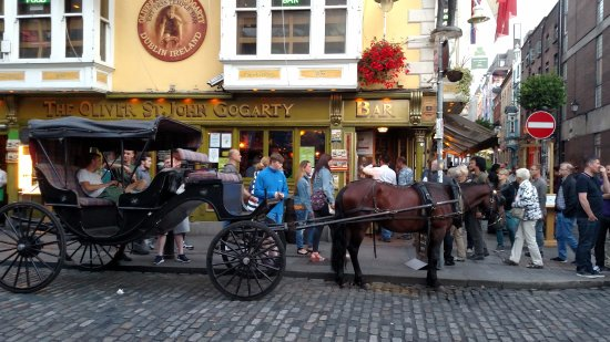 Horse cart in front of Oliver St. John Gogarty's pub
