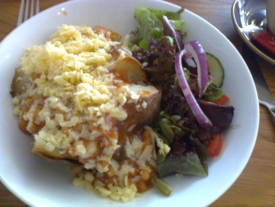 Jacket Potato With Baked Beans Grated Cheese And Side Salad At