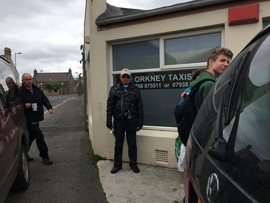 Киркуолл, UK: The Orkney Taxis driver is the fellow on the left approaching his taxi station.   For the wall o
