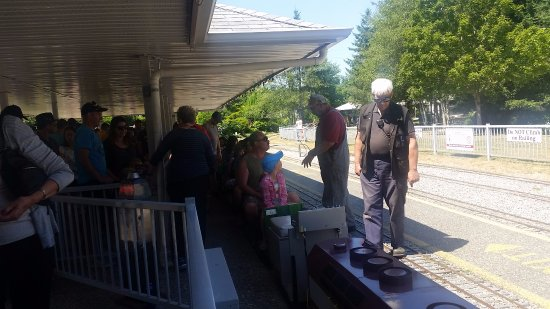 Burnaby, Canada: Miniature train rides - engineer and conductor checking safety