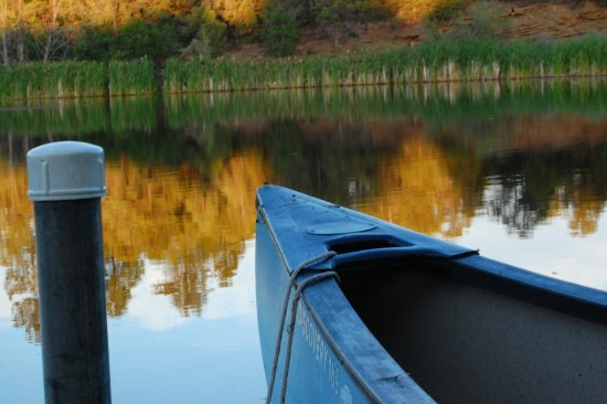 Mancos, CO: pond with canoes to go out on pond