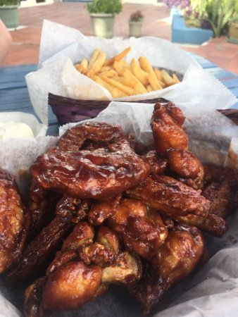 Wingz -N- Tingz: Honey BBQ wings (16 wings & fries meal- 50EC)