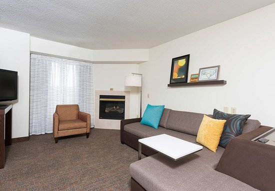 Grandville, MI: Studio Queen Suite - Living Area with Fireplace