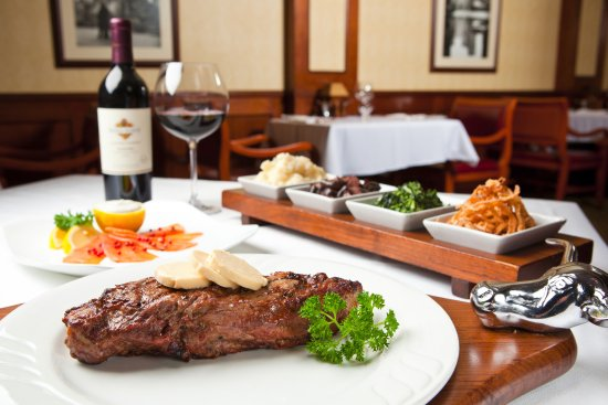 Manhattan Steakhouse: Certified Angus Beef Striploin served with our Signature Vegetable Board