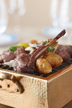 Mix grilled selection of lamb kofta, veal kebab, lamb chops, shish tawook