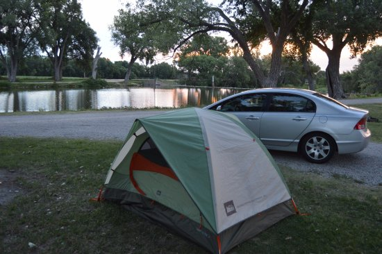 Ellis, KS: Our campsite on the East end of the campground. Lake runs along the length of the campground.