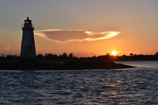 Captain Mike's Dolphin Tours: Beautiful Cockspur lighthouse at sunset