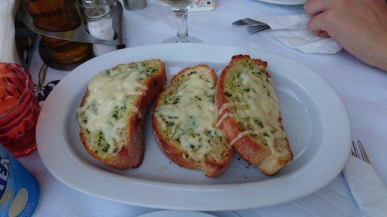 Μανώλης Ταβέρνα Εστιατόριο: Garlic Bread Logo