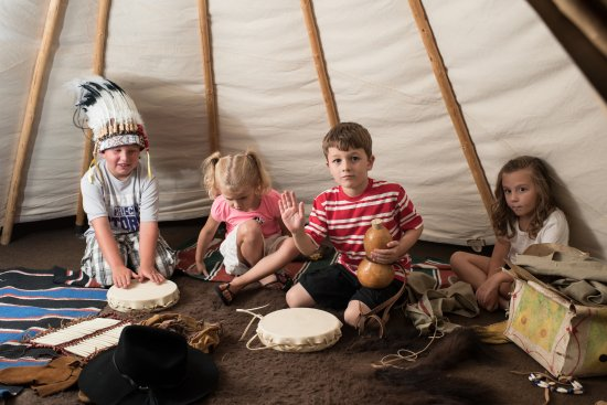 Hastings, NE: Kids playing in the Plains Indian Tipi