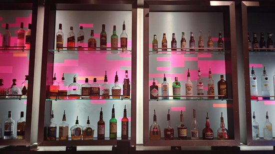 Aloft Charlotte Uptown at the EpiCentre: very modern hotel back drop of bar area