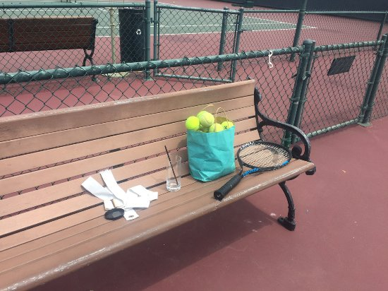 Del Mar, CA: This is how they give you the tennis balls - our water glass and someone else's trash 48 hours l