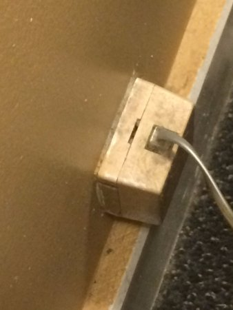 Belle Isle Motel: Phone jack and mop boards behind bed/nightstand