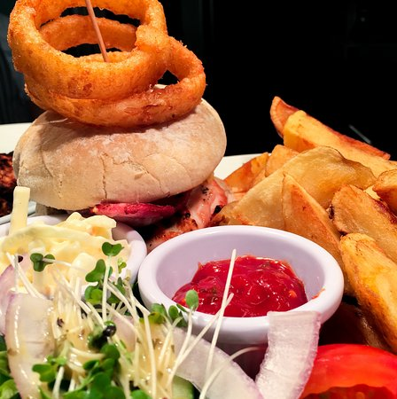 Chicken breast burger with cheese & bacon with hand-cut chips at The Driftwood, Trearddur Bay