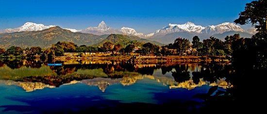 Pokhara, Nepal: Machhapuchhre and Annapurna mountain ranges getting reflected on the Phewa Lake
