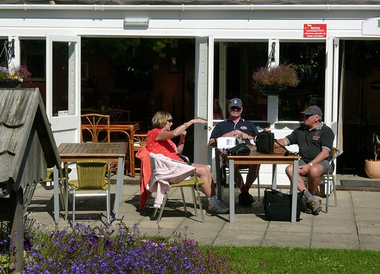 Alderney, UK: On the sun-drenched patio, enjoying drinks.