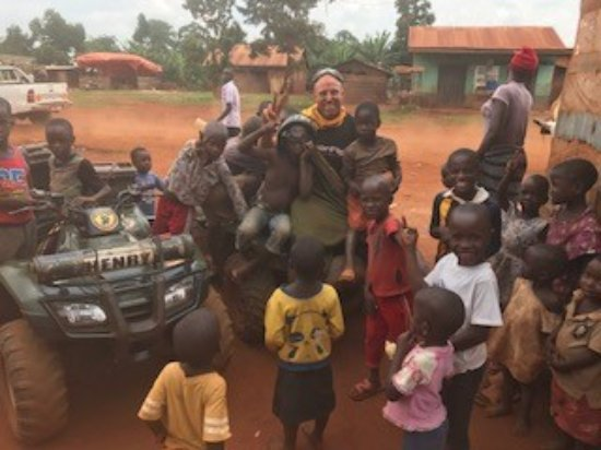 Jinja, Uganda: In the local village after buying biscuits for the kids