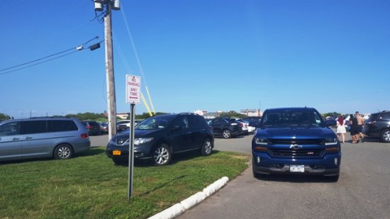 "Long Beach, NY: Cars Park on Front of the sign that indicate ""NO PARKING ANY TIME"""