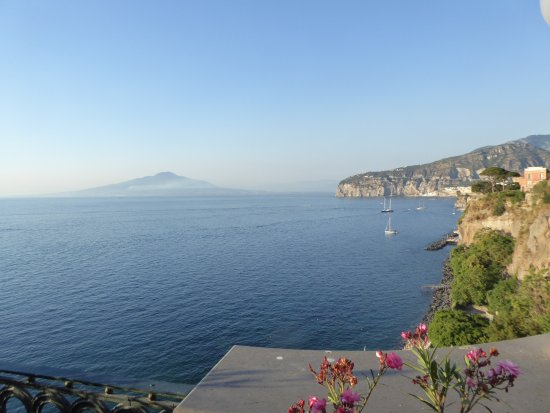 Europa Palace Grand Hotel: A view from the hotel terrace with Vesuvius in the distance.