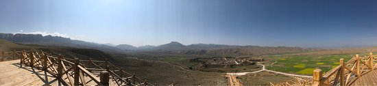 Xiahe County, China: Bajiao town from afar, the lookout behind the town, inside as well as atop the ancient wall