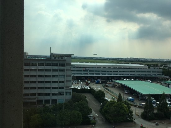 Ramada Pudong Airport Shanghai: Views from my room 817 towards the terminals and runway and the very important shuttle timetable