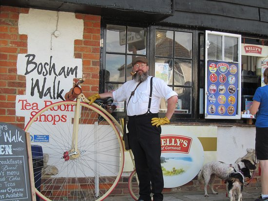 Horley, UK: Came across this amiable chap on a penny-farthing in Bosham.