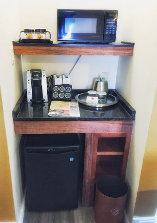 The Independent Hotel: Microwave, fridge and coffee maker in room.