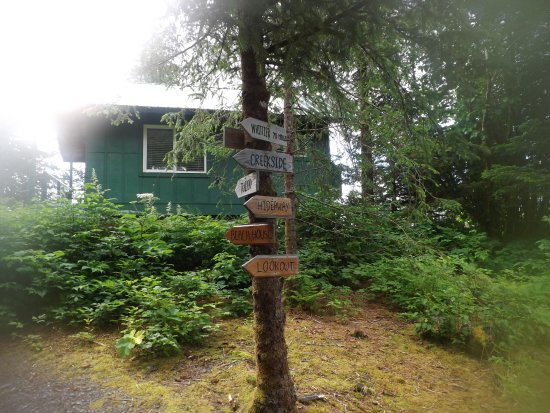 Chenega Bay, AK : home made signage with cabin in background