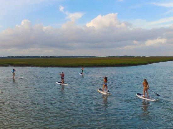 Folly Beach, SC: Paddleboarding along the beautiful Folly River.