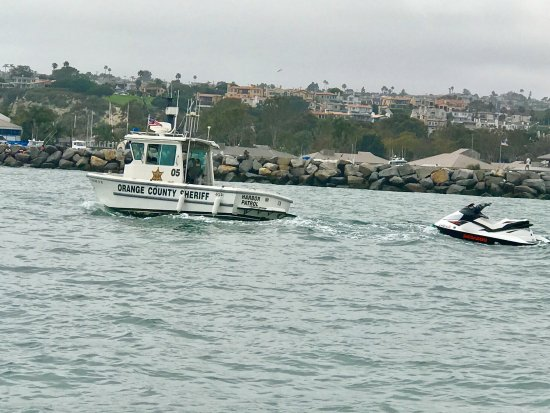 DANA POINT HARBOR, Orange County Sheriff, Harbor Patrol, bringing in abandoned Jet Ski after a c