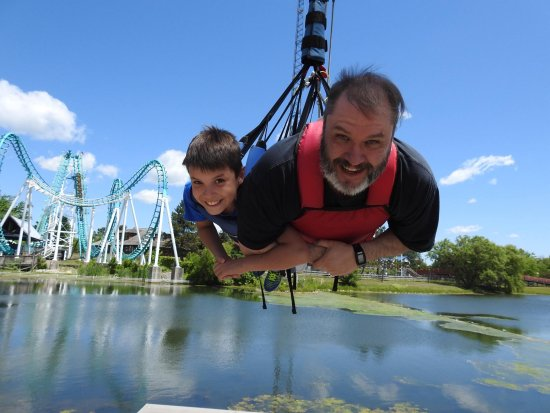 Darien Center, NY: My younger son and I enjoying an adrenaline pumping ride on the Red Hawk amusement attraction.