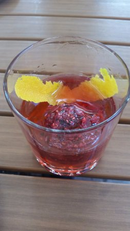 Rustique Bistro: Amazingly tasty raspberry vodka drink w/a frozen mash ball of deliciousness!