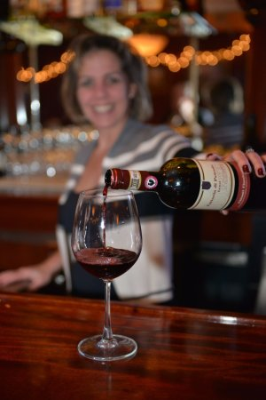 Marcello's Cucina Italiana: Bar Manager Kelly Adams pouring a glass of our favorite Chianti