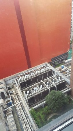 Swissotel Grand Shanghai: View of noisy air con units outside my room