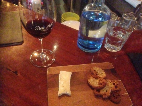 "Bon Ap' Petit Bistro: late afternoon (4-6pm) ""Happy Hour"" - a glass of French red wine with cheese."