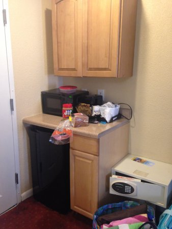 Days Inn Ocean City Oceanfront: Mini fridge area, top cabinet opens (empty), bottom cabinet and drawer are decorative