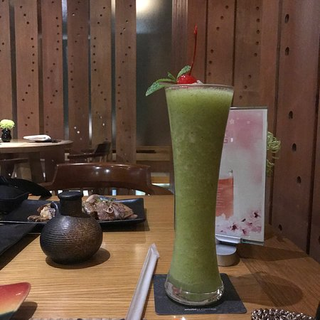 Takumi Japanese Restaurant : The green drink is the mocktail (really nice!) and some sashimi, beef dish and sushi dishes. And