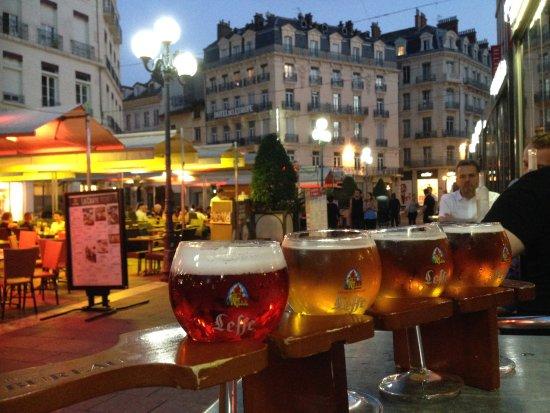 Belgian beers with hotel leurope behind picture of au bureau