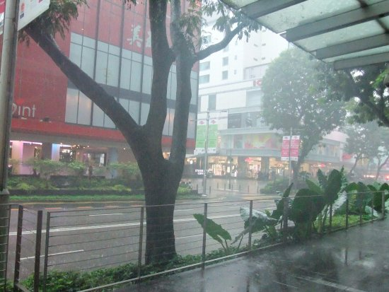 Dodging the rain on Orchard Road