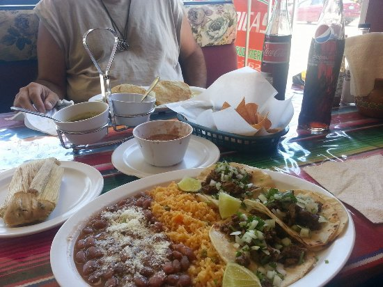 Bremerton, WA: Foreground is the taco platter with beans and rice. Tamale on th side.